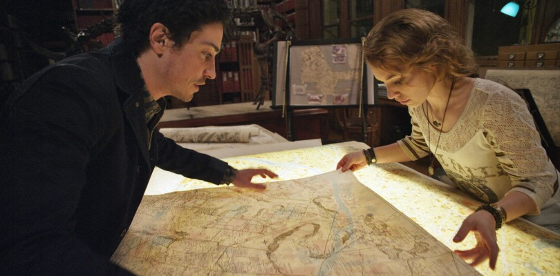 George (BEN FELDMAN) and Scarlett (PERDITA WEEKS) map their quest through miles of twisting catacombs beneath the streets of Paris in As Above/So Below.