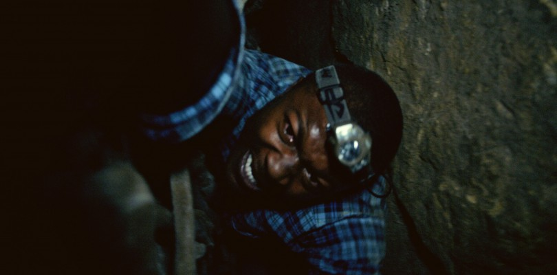Benji (EDWIN HODGE) is trapped in the twisting catacombs beneath the streets of Paris in As Above/So Below.